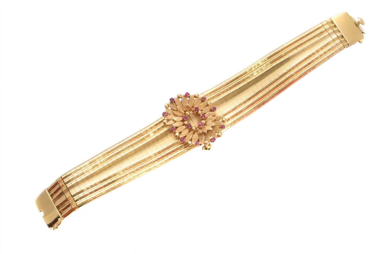 Lot 21-An 18ct gold ruby bracelet