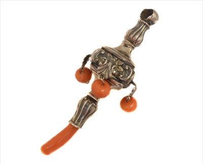 Lot 1-An Edwardian silver and coral rattle