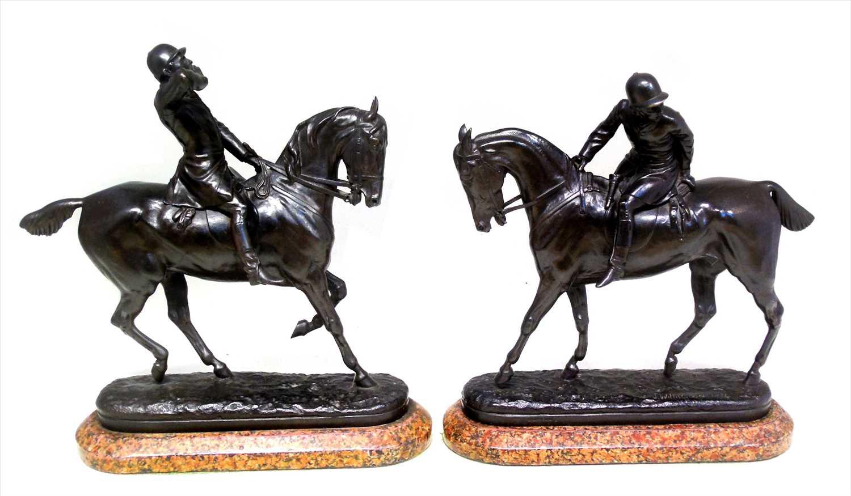 174 - Pair of bronze figures of huntsmen
