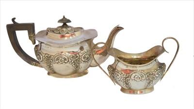 Lot 40-An Edwardian silver teapot and sugar bowl