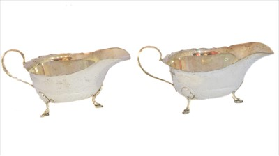 Lot 37-A pair of George VI silver sauce boats