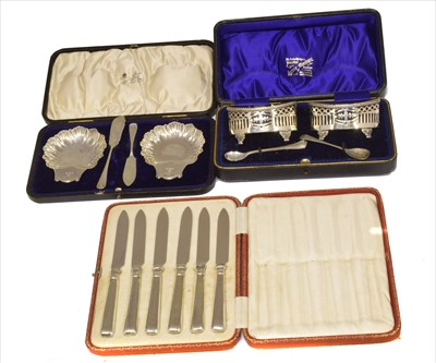 Lot 38-Three sets of Victorian and later cased silver cutlery