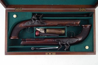 Lot 33-Pair of William Bond pair of 16 bore officer's pistols in later case