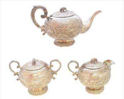 Lot 45-An Indian white metal three piece tea set
