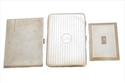 Lot 50-Three silver cigarette cases.