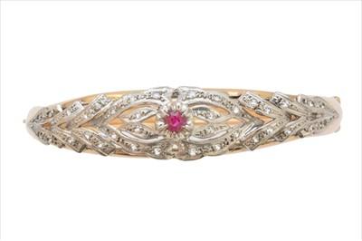 Lot 6-A ruby and diamond hinged bangle