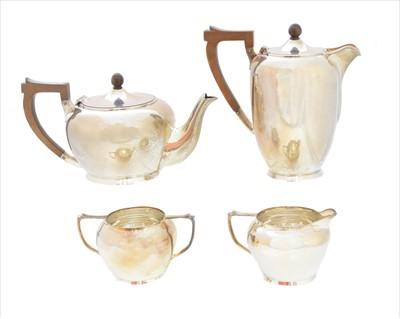 Lot 55-A George VI silver four piece tea set