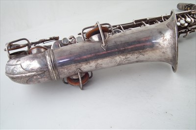 Lot 34-Conn C Melody Saxophone in case.