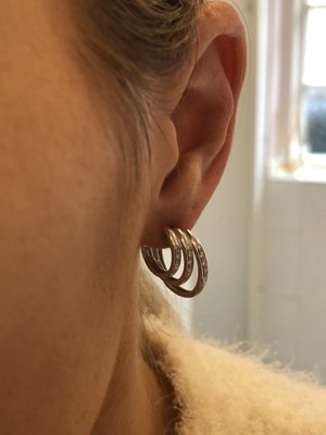 Lot 44-A pair of 18ct gold diamond earrings