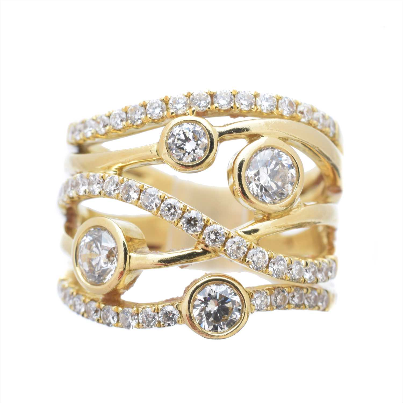 Lot 227-An 18ct gold diamond 'Lunar' diamond ring by David M Robinson
