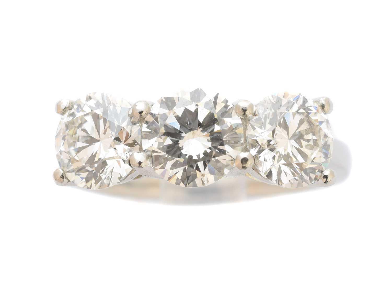 Lot 249-A platinum diamond three stone ring