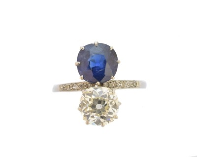 Lot 184-An early 20th century diamond and Basaltic sapphire toi et moi ring