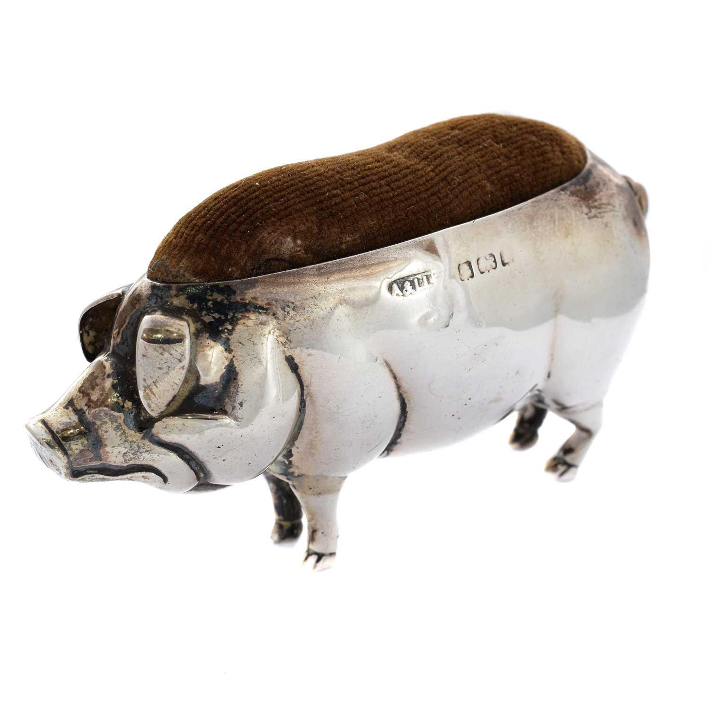 Lot 30-An Edwardian novelty silver pig pin cushion