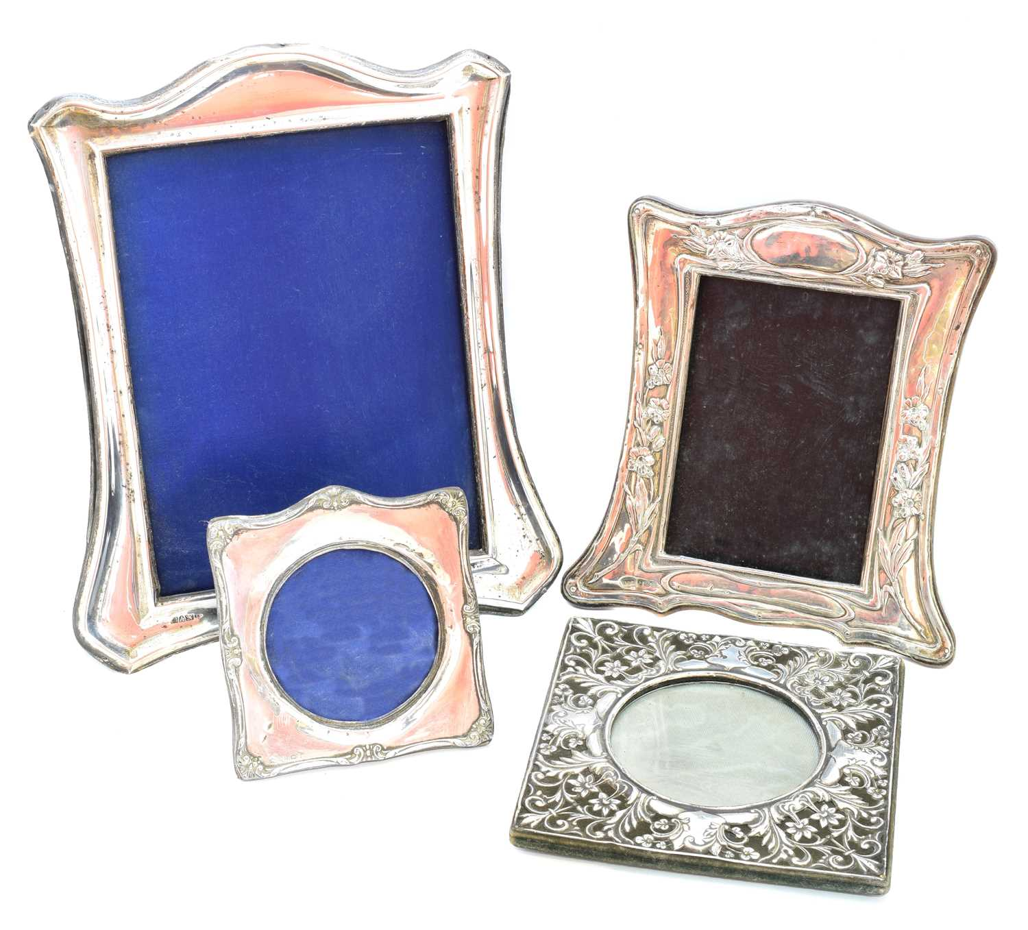 Lot 31-Four early 20th century silver fronted picture frames