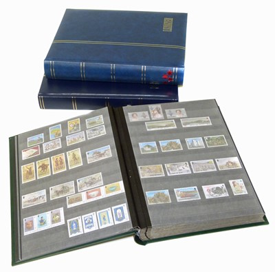 Lot 83-Channel Islands, Isle of Man stamps in 2 lindner stockbooks, plus a further volume of Ireland.
