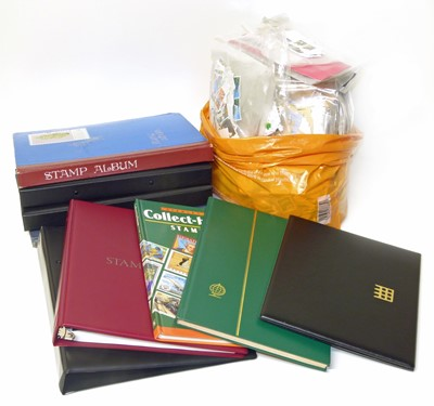 Lot 74-All World stamp collection in carton of 8 albums (one of USA) and large bag of loose and in packets.