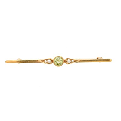 Lot 28-An early 20th century peridot and split pearl brooch by Murrle Bennett & Co.