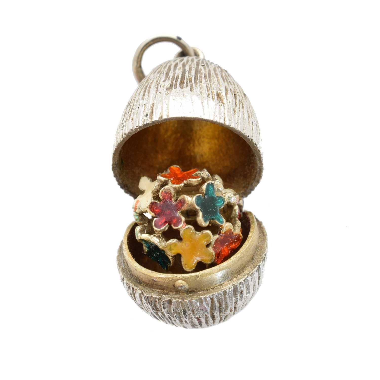 Lot 62-A silver and enamel egg pendant by Stuart Devlin