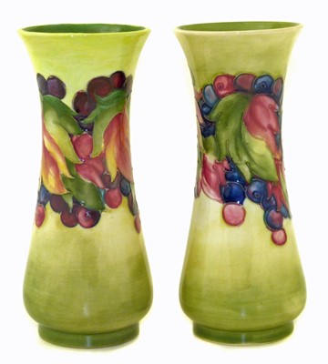 Lot 102 - Pair of Moorcroft leaf and berry vases