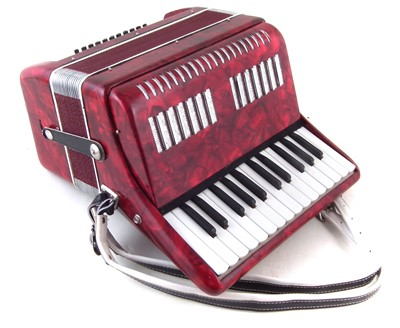 Lot 47-Unnamed piano accordion in case.