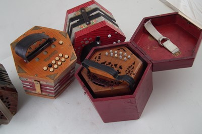 Lot 48-Four Concertinas, one with case.