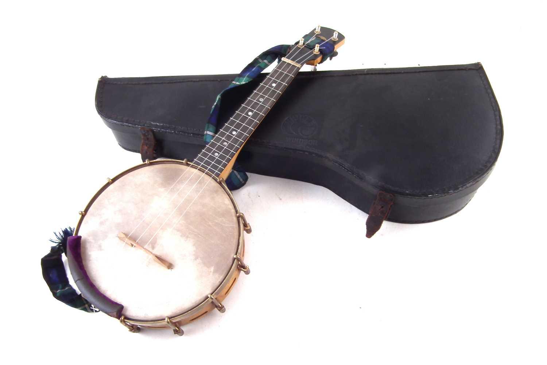 Lot 20-Windsor Whirle Banjolele or ukulele banjo with original case.
