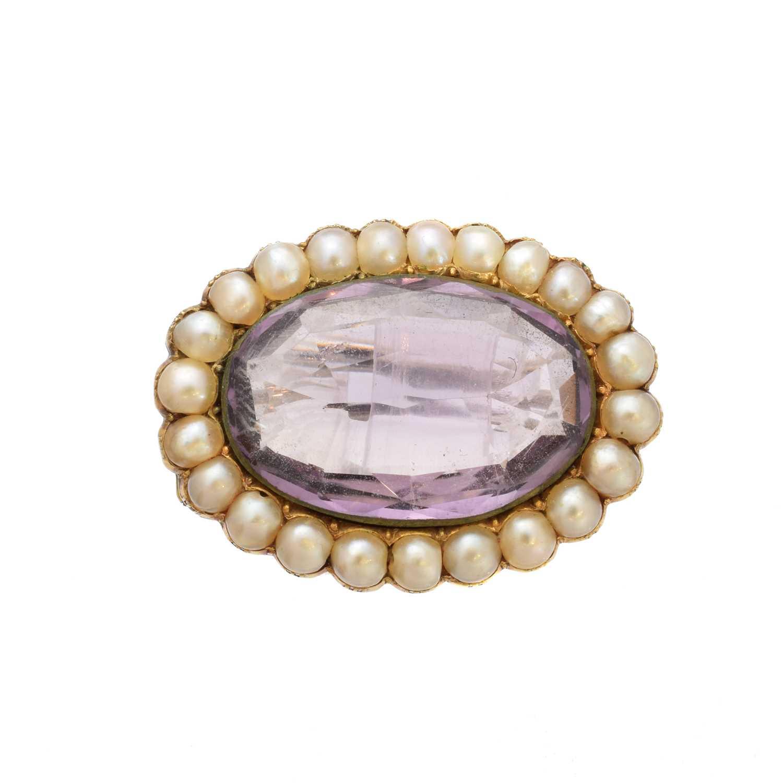Lot 21-An amethyst and split pearl brooch