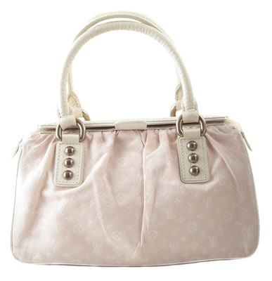 Lot 26-A Louis Vuitton Pink Monogram Trapeze PM Handbag