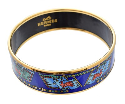 Lot 46-A Hermès 'Flag' gold-tone enamel bangle bracelet