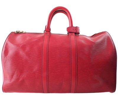 Lot 57 - A Louis Vuitton red Epi Keepall 45 luggage bag
