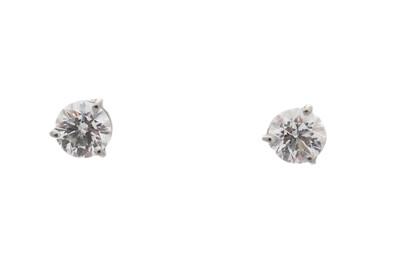 Lot 41-A pair of brilliant-cut diamond stud earrings