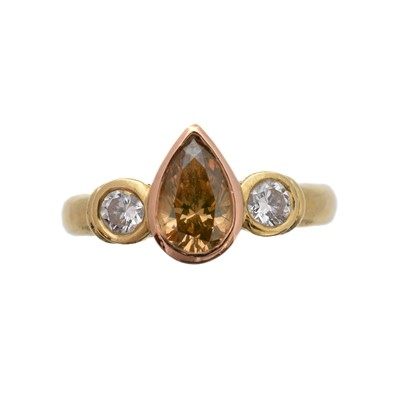 Lot 162 - A 'brown' diamond and diamond three stone ring