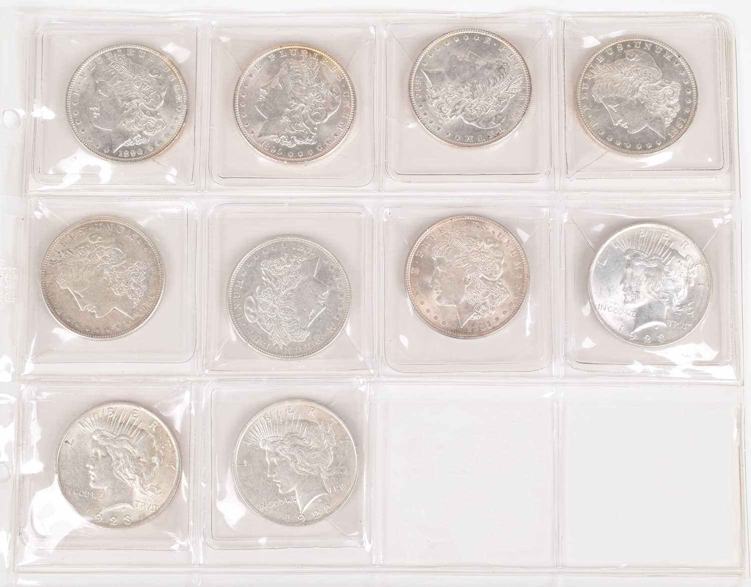 Lot 4-One sheet of silver Morgan and Peace Dollars (10).
