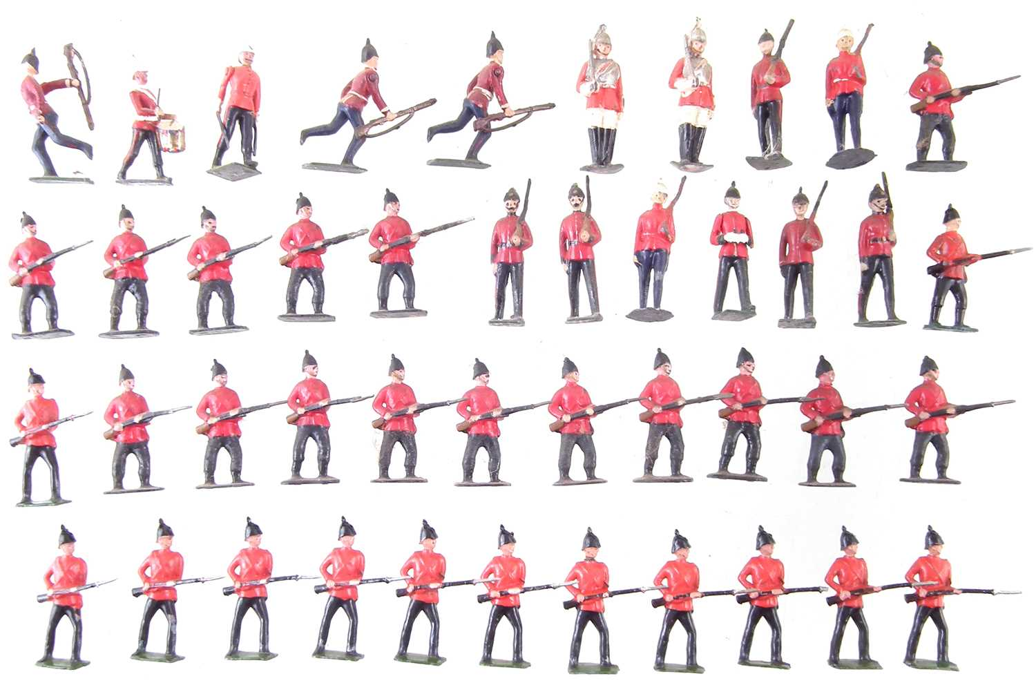 Lot 35-Forty four British army metal soldiers by J. Hill and Co. and Britains.