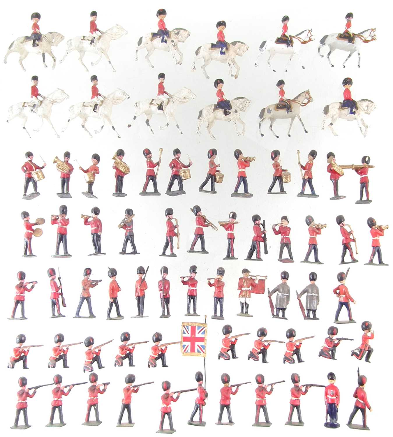Lot 33-Fifty seven metal British infantry soldiers by J. Hill and Co. and twelve mounted troopers.