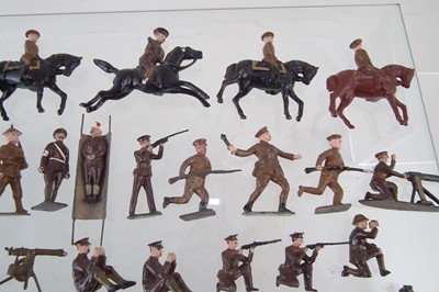 Lot 30-Eighty six WWI metal British Infantry soldiers by J. Hill and Co and other makers, also Seven mounted soldiers.