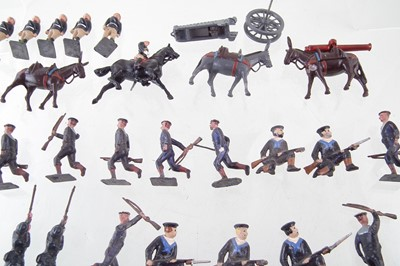 Lot 32-Fifteen metal Prussian infantry soldiers, also twenty British Marines, and an artillery unit.