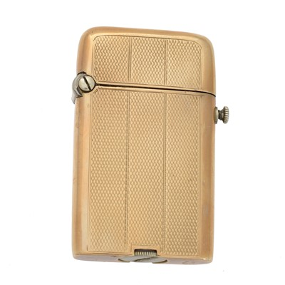 Lot 108 - A yellow metal lighter by Thorens