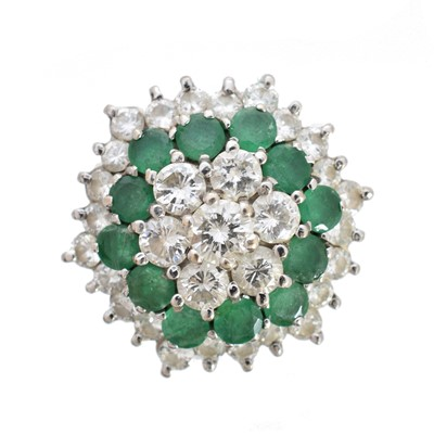 Lot -An emerald and diamond cluster ring