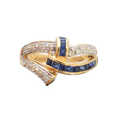Lot 99 - A sapphire and diamond dress ring