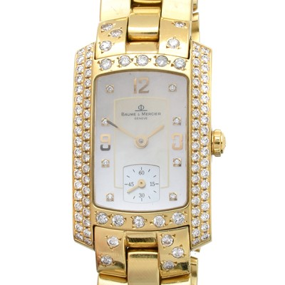 Lot 257-An 18ct gold diamond Baume & Mercier 'Hampton Classic' watch