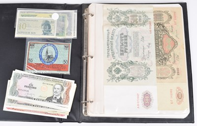 Lot 31-One album of assorted world banknotes.