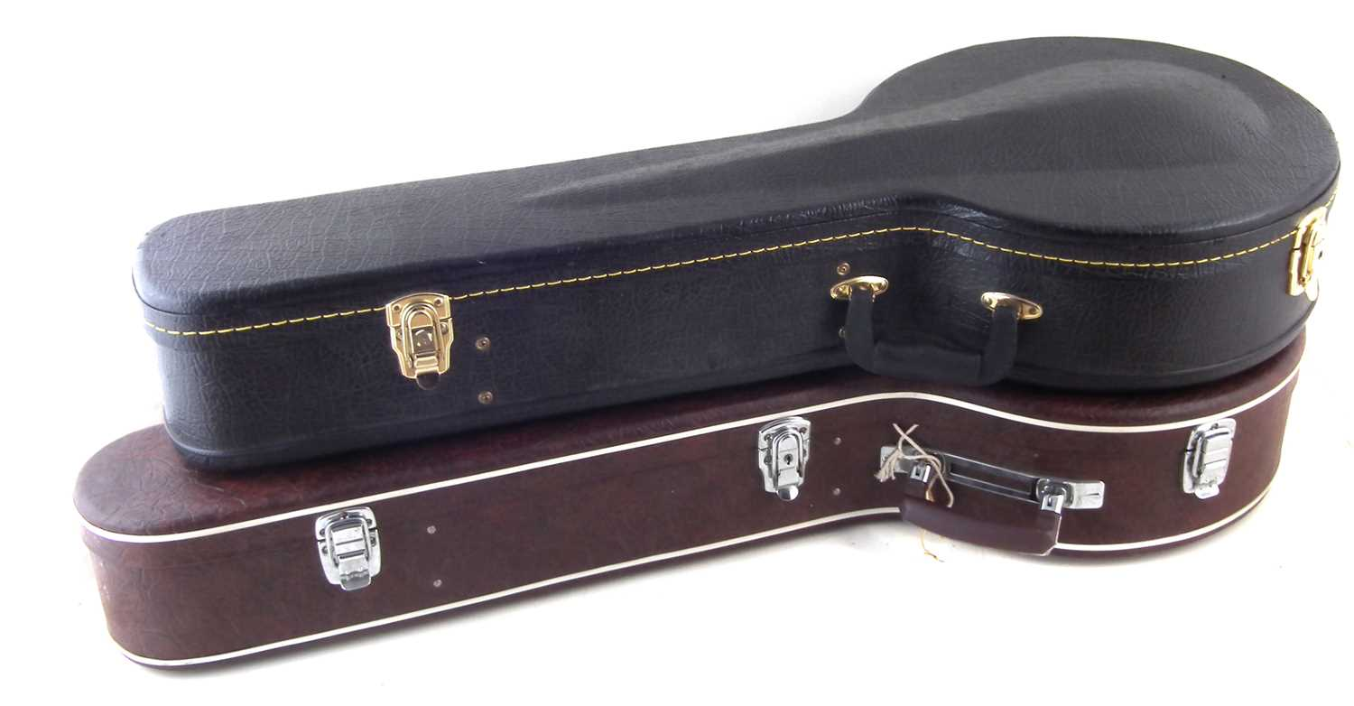 Lot 15-Two Banjo cases and a autoharp