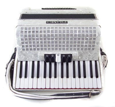 Lot 37-Primo piano accordion in case