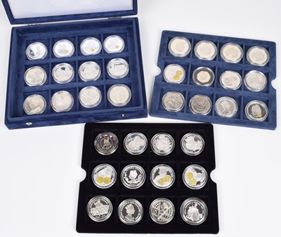 Lot 14-Cased set of 36 silver proof coins to include many commemorative sized crowns, fifty pences etc.