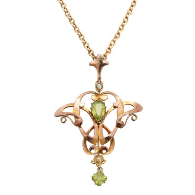 Lot 107 - An early 20th century peridot and seed pearl pendant