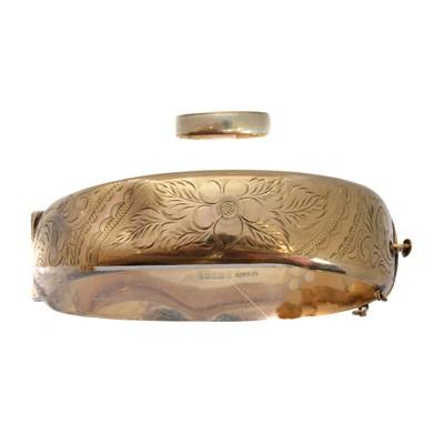 Lot 13 - A 9ct gold hinged bangle