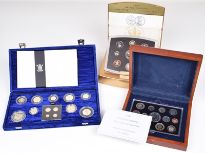 Lot 83-Collection of Annual Proof Coin Sets and five albums of Royal Family first-day coin covers.