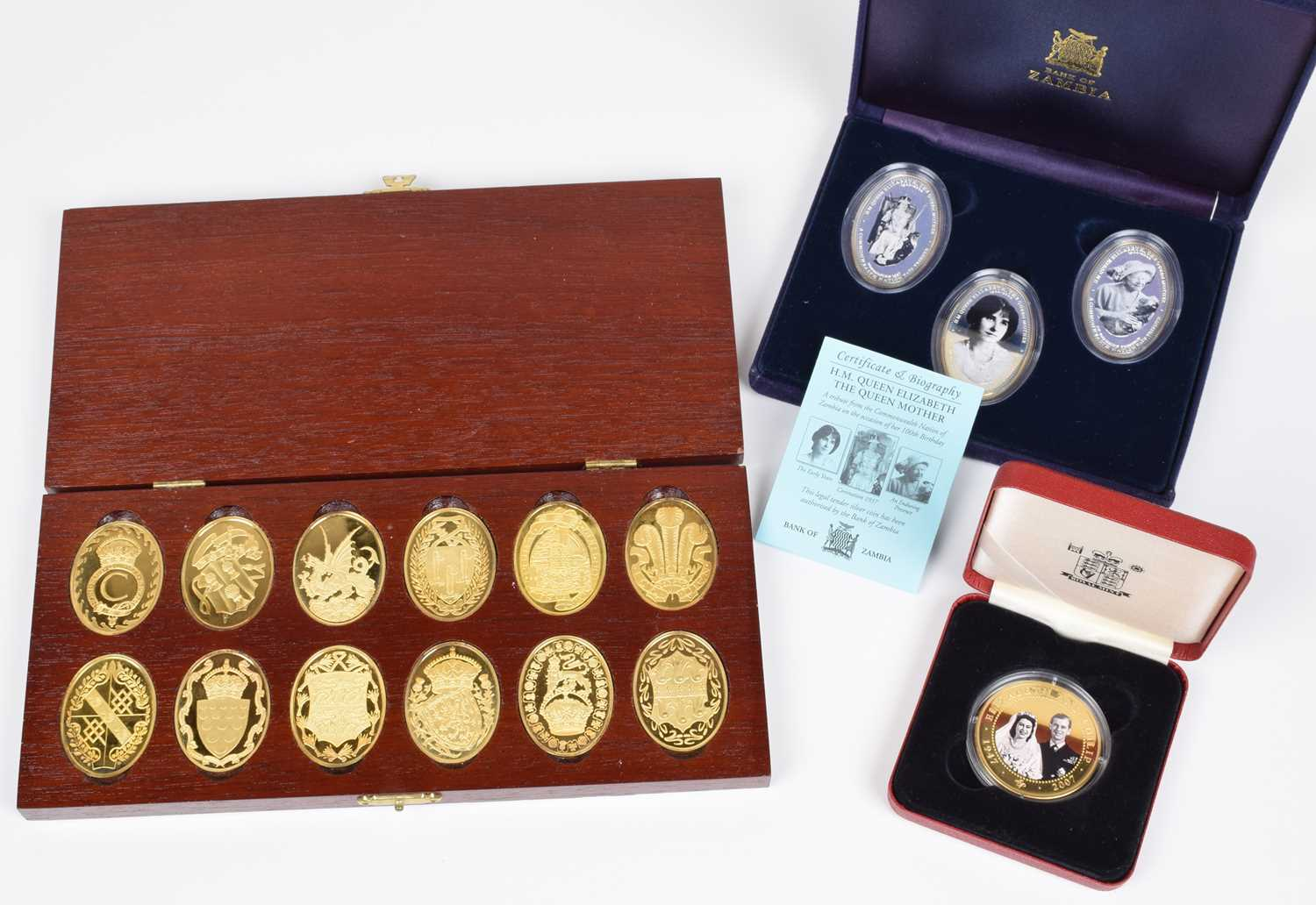 Lot 8-A cased set of twelve hallmarked silver gilt medallions and other cased gold-plated coin sets.