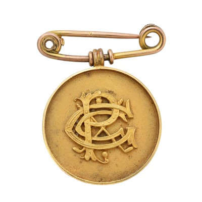 Lot 24-An early 20th century 18ct gold medallion